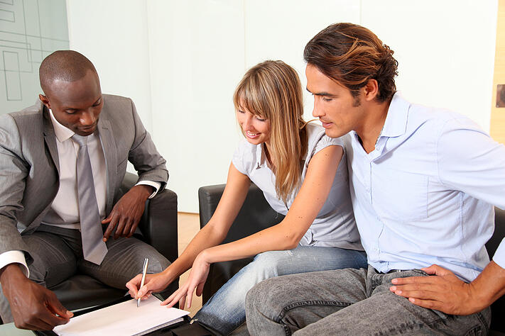 Couple signing home-purchase contract-2